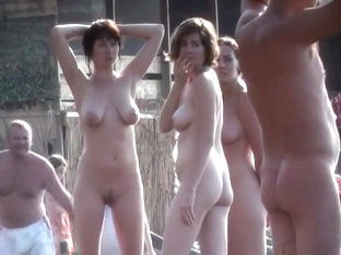 Group Of Nudist Women And Men Walk Around Completely Naked