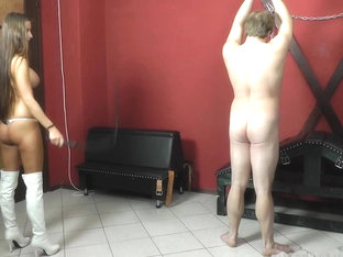 Slave Gets A Harsh Whipping By Hot Brunette Mistress