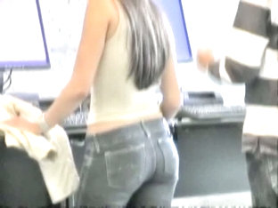 Tight Ass In Jeans Woman Showing Her Curves For The Voyeur Camera