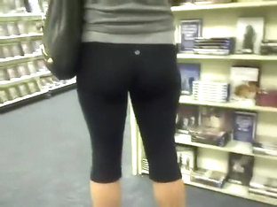 Sexy Girl In Tights At The Book Store